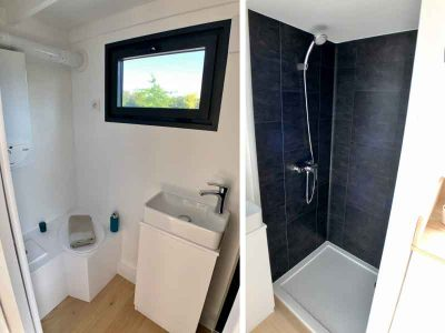 Les sanitaires ou salle d'eau contiennent les W.C. (toilettes sèches), un chauffe-eau instantané, une douche une VMC, une douche, un lavabo pour ce modèle La Familiale (8 personnes) réalisé dans le Perche (Sarthe, orne et Eure et loir) près de Chartres, Le Mans et Alençon.